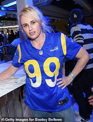Confident:The actor, 41, appeared to be in her element as she flashed a beaming smile for the camera while sporting a blue-and-yellow Los Angeles Rams soccer jersey