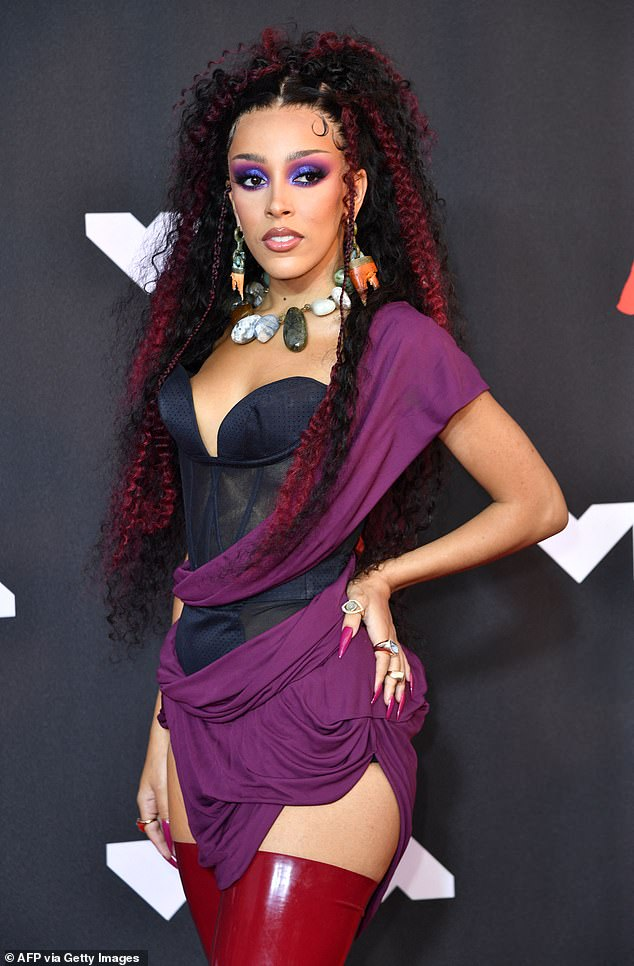 Red carpet: Walking the red carpet ahead of the ceremony, Doja Cat wowed in a toga-inspired Vivienne Westwood look