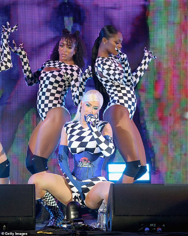 Giving her all: Iggy worked her curves as she posed up a storm while belting out lyrics