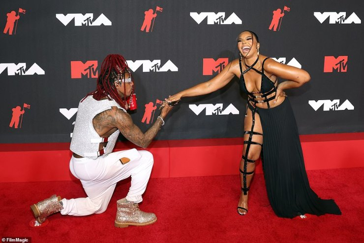 Bowled over:She looked so incredibly sexy that Nick Cannon got on his knees to kiss the songstress on the hand