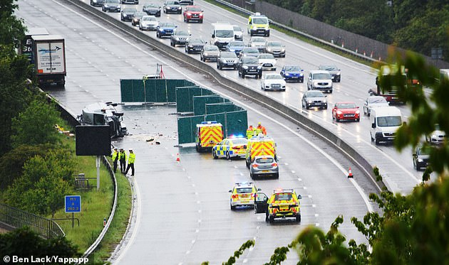 The signs on some smart motorways could not be changed along parts of the M1, M4, M5 and M62 following a computer bug in April, leading an insider at National Highways to warn that 'someone is going to get killed' (Pictured: The scene of a crash in June 2019)