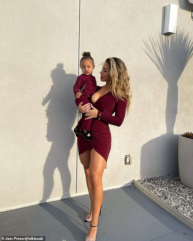 Niki, pictured with Aria, said her daughter was her biggest motivation. But the trainer said she didn't believe being pregnant 'ruined' women's bodies
