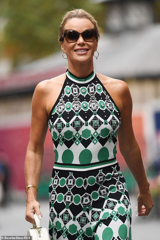 Retro chic: The 51-year-old Britain's Got Talent judge was still proudly flaunting a Grecian glow, however, donning a retro-print halterneck jumpsuit, showing off her toned tanned arms