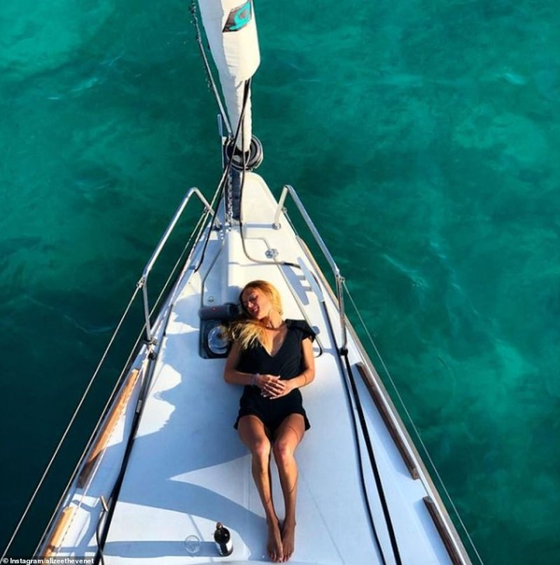 The finance guru is fluent in three languages having lived in six countries - Germany, Indonesia, Chile, France, Belgium and England – as the Thevenet travelled the world. She is pictured relaxing on holiday last year
