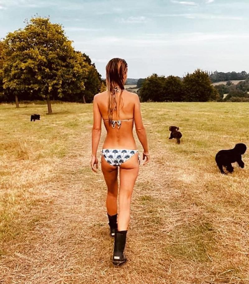 James shared a photo of his stunning French bride Alizée walking the dogs in nothing more than a pair of boots and a bikini, pictured