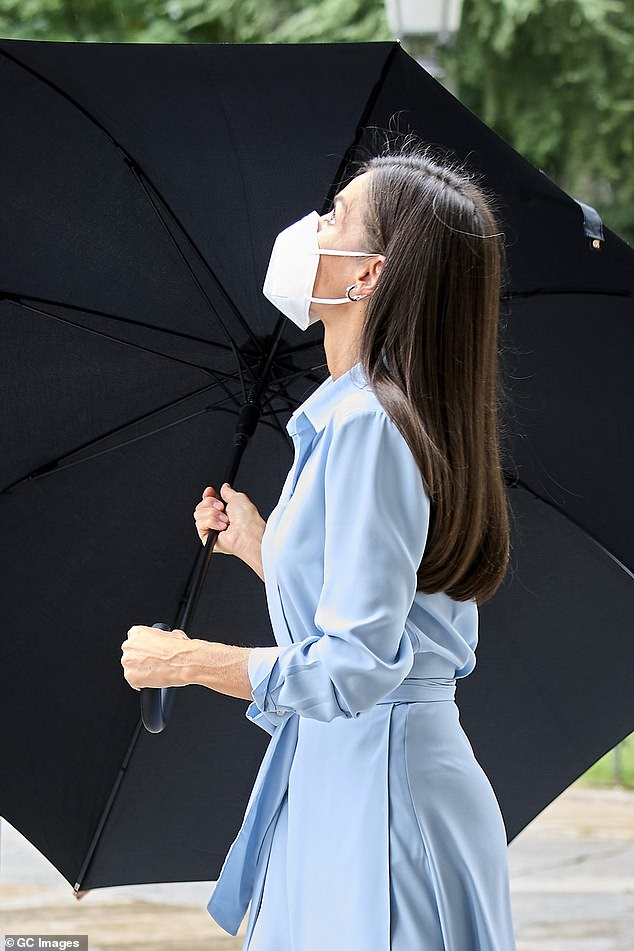 Putting safety first, the mother-of-two donned a plain white face mask. Spanish guidelines state that face coverings must be worn in any enclosed space open to the public