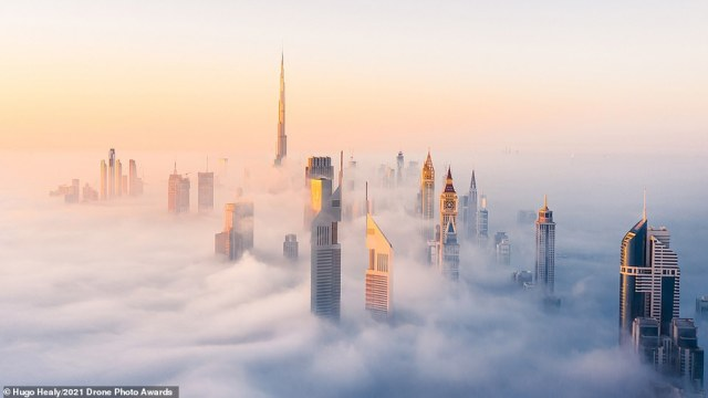 A foggy morning in downtown Dubai led to a commended accolade forHugo Healy in the Urban category. Healy says the 'very rare' fog was 'caused by the cold nights and warm mornings'. He admitted the conditions created the 'perfect scene for an aerial photo', with the city's skyscrapers 'emerging out of the low clouds and creating an impression that the city is floating in the sky'