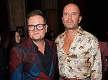 Alan Carr reveals he quit booze to support alcoholic husband Paul through recovery