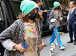 Cara Delevingne nails shabby-chic in tracksuit bottoms and slippers as she arrives at New York hotel