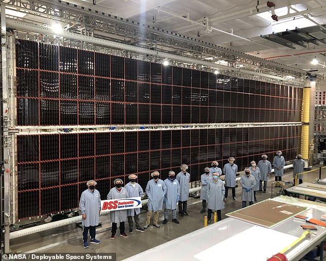 According to NASA, the new solar arrays — which will be placed in front of the existing ones — will boost the station's available power from 160 to 215 kilowatts. Pictured: one of the new roll-out solar arrays which are being installed on the ISS