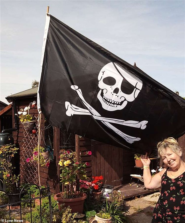 Maria Lambert said Breckland Council told her to remove the skull and crossbones after a complaint was made on August 24. Officials then investigated and changed their minds, saying it could stay