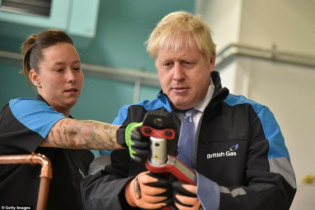 Boris Johnson (pictured visiting a British Gas training academy today) warned that Covid restrictions such as vaccine passports will be 'kept in reserve' in case of a winter surge