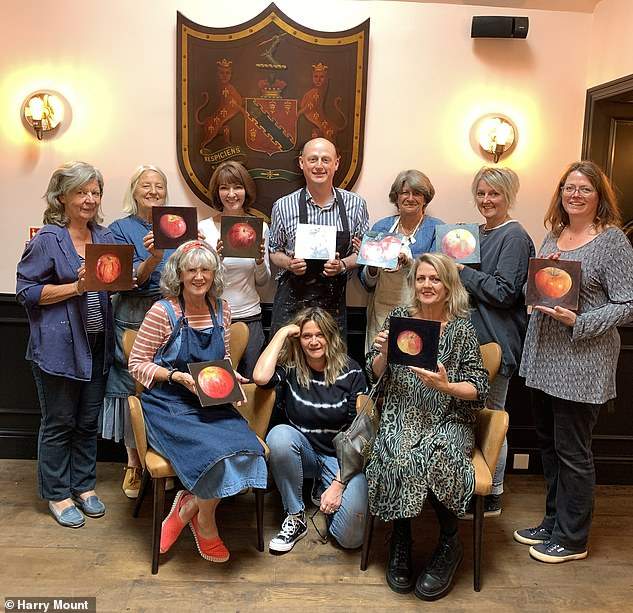 47780937 9980039 Fruits of their labour Harry s class present their apple paintin a 1 1631544384756