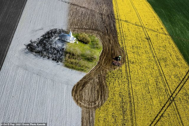 This astonishing image is one of a series of photographs captured by Ovi D Pop showing a lone chapel in the middle of a field in Kigyei Kapolna, Romania. It scoops a commended in the Urban category