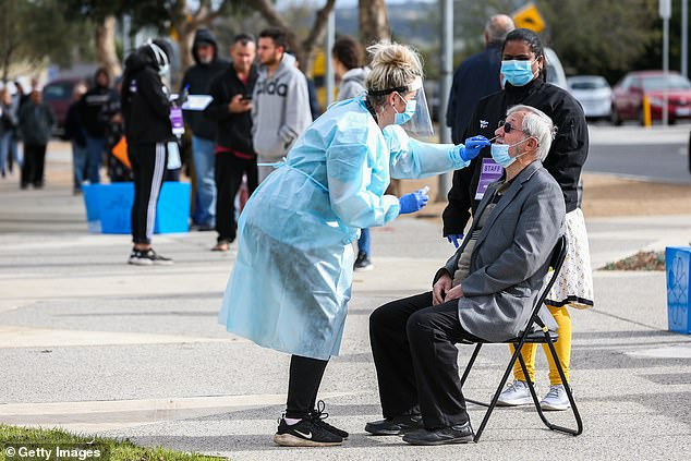 Seventeen cases of COVID-19 were tied to an outbreak at a nursing home in France that had fully vaccinated more than 90% of residents. Despite the population being vulnerable to the virus, only one death occurred and it was an unvaccinated resident. Pictured: An elderly Australian man is tested for COVID-19 in Melbourne on July 2