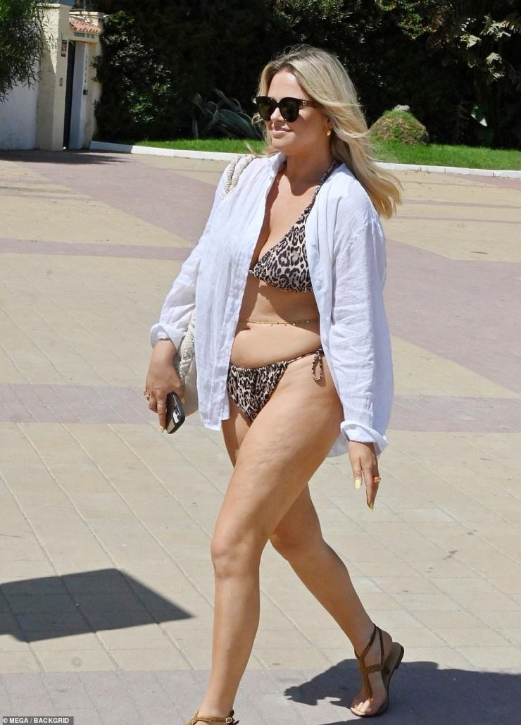 Gorgeous: Emily looked gorgeous with her bikini layered beneath a chic white shirt worn unbuttoned