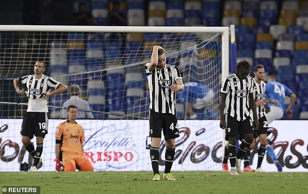 Juventus players react with dismay after losing late on to Napoli on Saturday evening