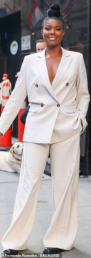 She means business! Gabrielle first turned heads at Good Morning America, where she took the plunge in a taupe suit with leather loafers