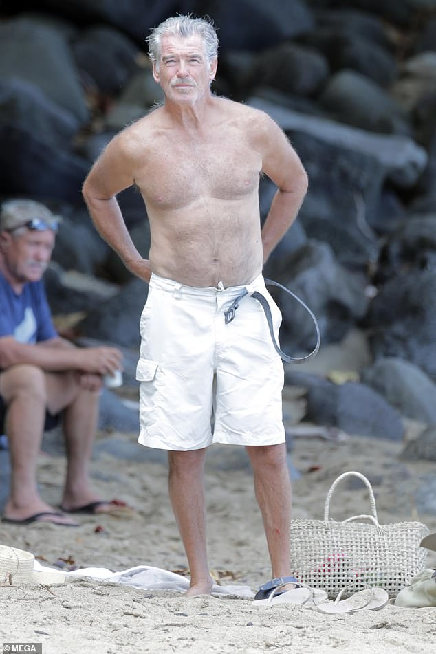 Casual:The former James Bond star also donned a pair of white knee-length shorts for some of the trip