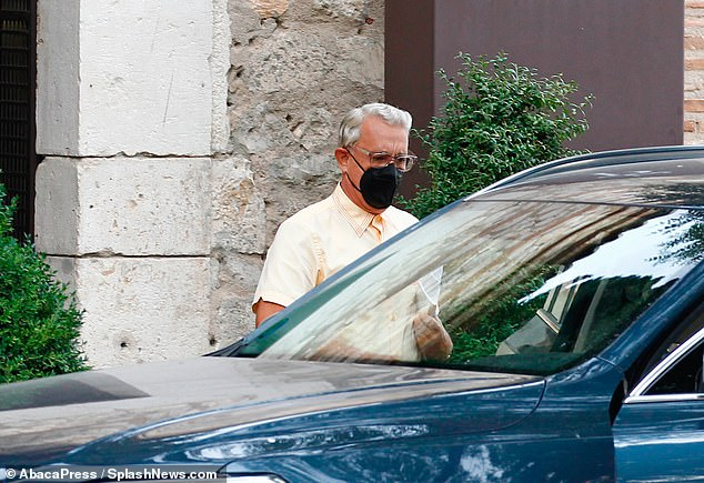 Silver fox:Tom Hanks debuted freshly-dyed white hair as he headed out to film Wes Anderson star-studded new film project in Spain on Sunday