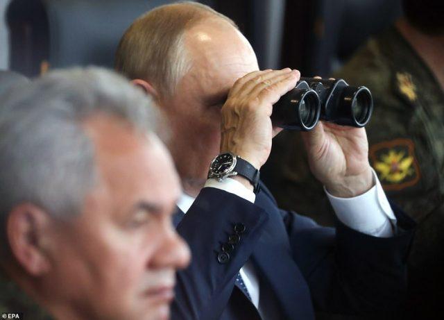 Russian President Vladimir Putin (right) was today overseeing huge military exercises at the Mulino range in the Nizhny Novgorod region