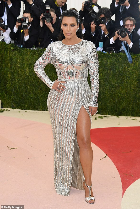 Sterling silver:Kardashian tried out silver at the Manus x Machina: Fashion In An Age Of Technology in 2016. She wore Balmain, a shimmery silver dress that looked like a futuristic gown with a slit up the side. Husband Kanye West was in the same designer