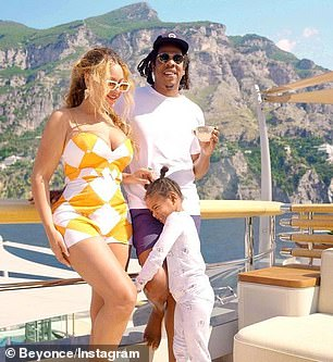 Good times: The 40-year-old singing sensation flashed her killer curves in a one-piece ensemble as she caught the sunset aboard Jeff Bezos' mega yacht with her family.