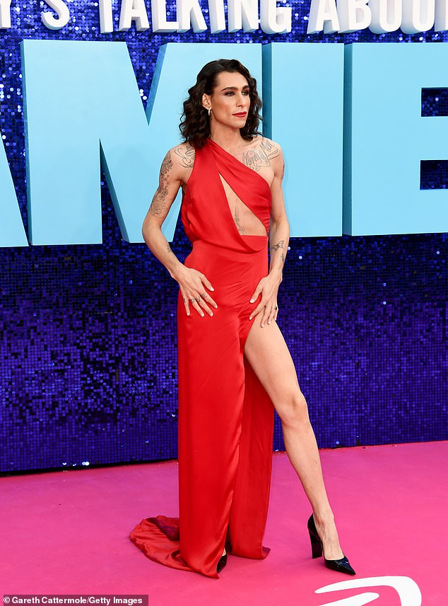 Event: Fashion designerKyle De'Volle opted for a red sleeveless gown with a high leg split