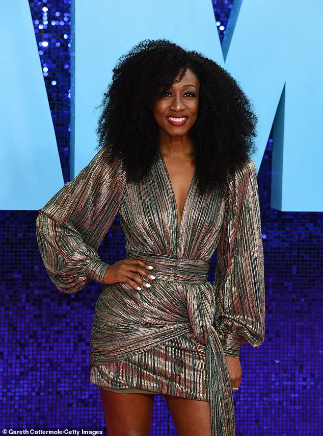 Sensational:Beverley Knight turned heads in a long-sleeved mini dress with a multi-coloured striped print