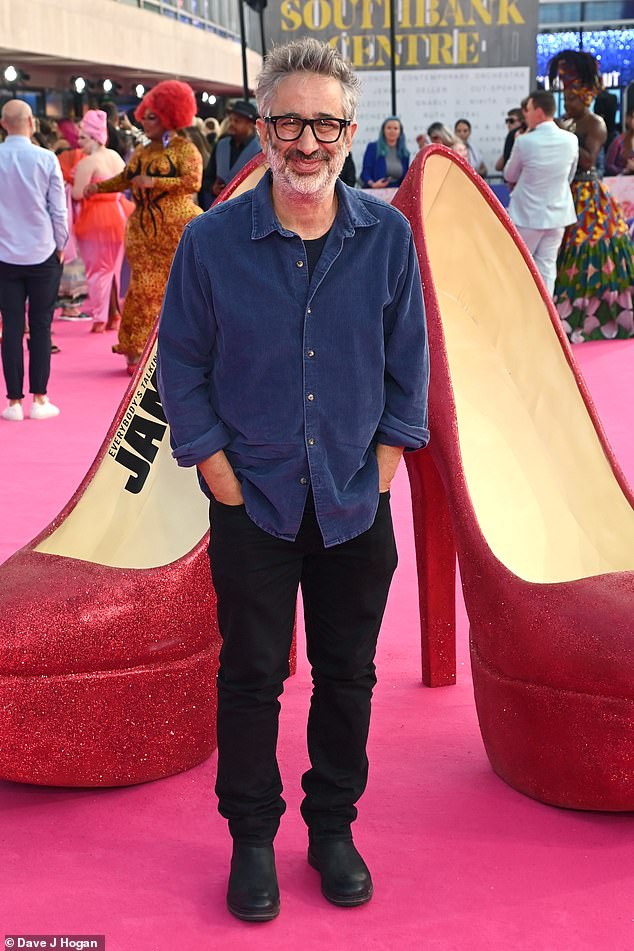 Laid back:David Baddiel kept it casual in a navy shirt and black trousers