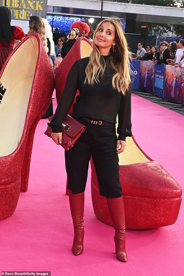 Pose: Louise Redknapp donned a black top and matching trousers as she attended the premiere of Everybody's Talking About Jamie at The Royal Festival Hall in London on Monday
