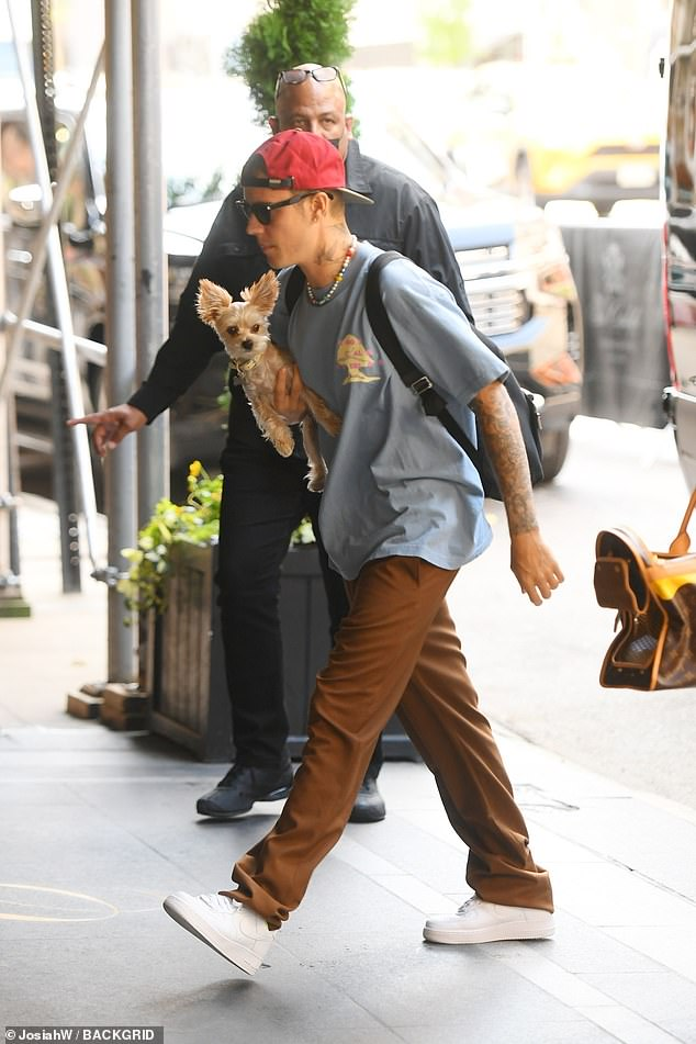 Winner:He won two Moon person trophies on Sunday night at the MTV VMAs. And one day later, Justin Bieber was spotted arriving to his New York City hotel with he and wife Hailey Bieber's dog Oscar on Monday