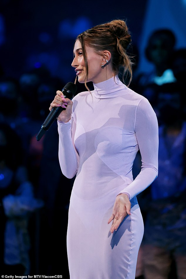 An absolute vision:The gorgeous model showcased her figure in the fitted number, which was long sleeved and had a turtleneck detail