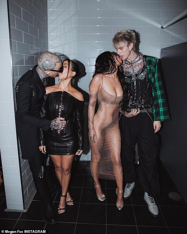 Pucker up: Proving they were real troublemakers, the ladies also got caught making out with their boyfriends Travis Barker and Machine Gun Kelly