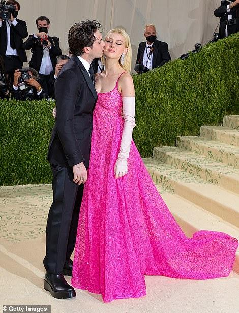 Sweet moment: Brooklyn Beckham and fiancee Nicola Peltz shared a PDA moment on the carpet