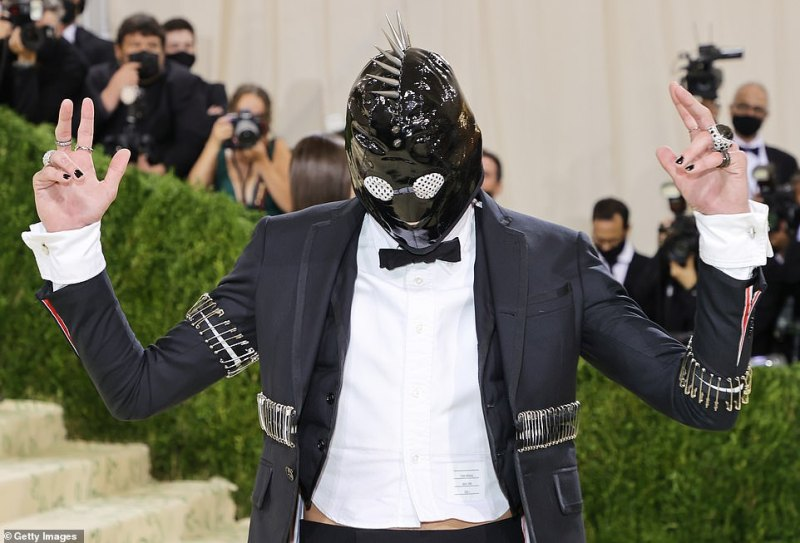 The pleather bondage-style accessory had netting across the eyes and a spiky mental mowhawk down the center of it