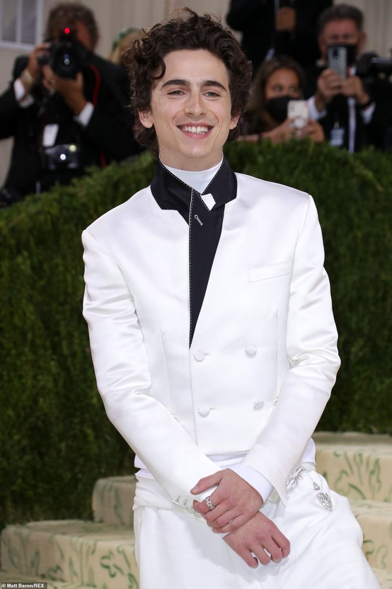 Gussied up: The actor rocked a silky white tuxedo with black detailing