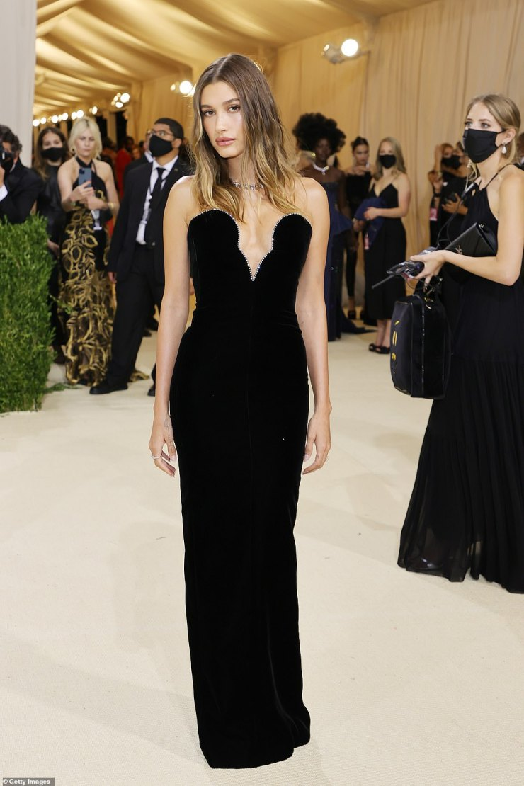 Timeless: Hailey Bieber donned a sleek black strapless Saint Laurent gown with crystal detailing along the bustline