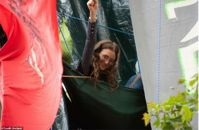 Eli Rose (pictured), 26, spent 16 days in a tree last September to protest the HS2 rail link. Ms Rose lived in the tree in Parliament Square because she 'cannot bear' knowing her potential future children will be born 'into a world where they will have to battle through food shortages and drought'