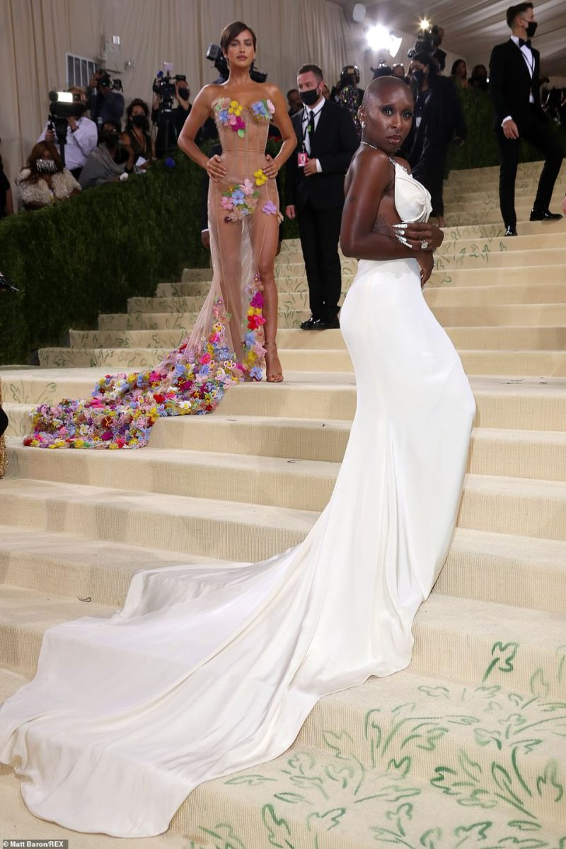 Flawless: Cynthia showed off her gown's flowing train as she arrived at the event