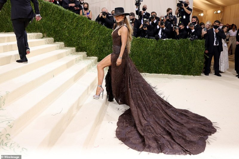 Sky-high: Jennifer climbed the Met's staircase in a pair of sky-high silver heels.