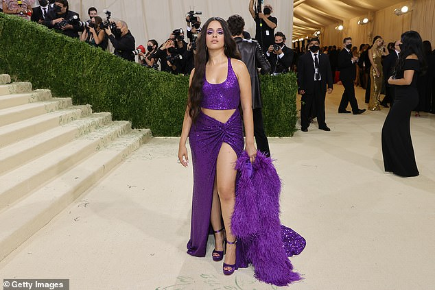 Revealing: Camila's crop top and skirt left a triangular cutout over her midriff, and the top of her skirt was ruched just below her tummy.