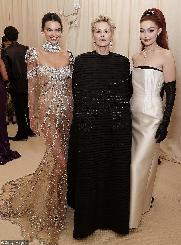 Drama:Inside, she posed with actress Sharon Stone and model pal Gigi Hadid, who each looked classic in their own monochrome garb