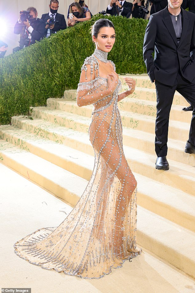 Dazzling: The skirt swept towards the floor, glittering with every movement the elder Jenner sister made