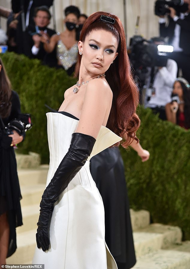 Custom creation:The 26-year-old model slipped her slender physique into a white strapless Prada gown with a dramatic slit down the backside