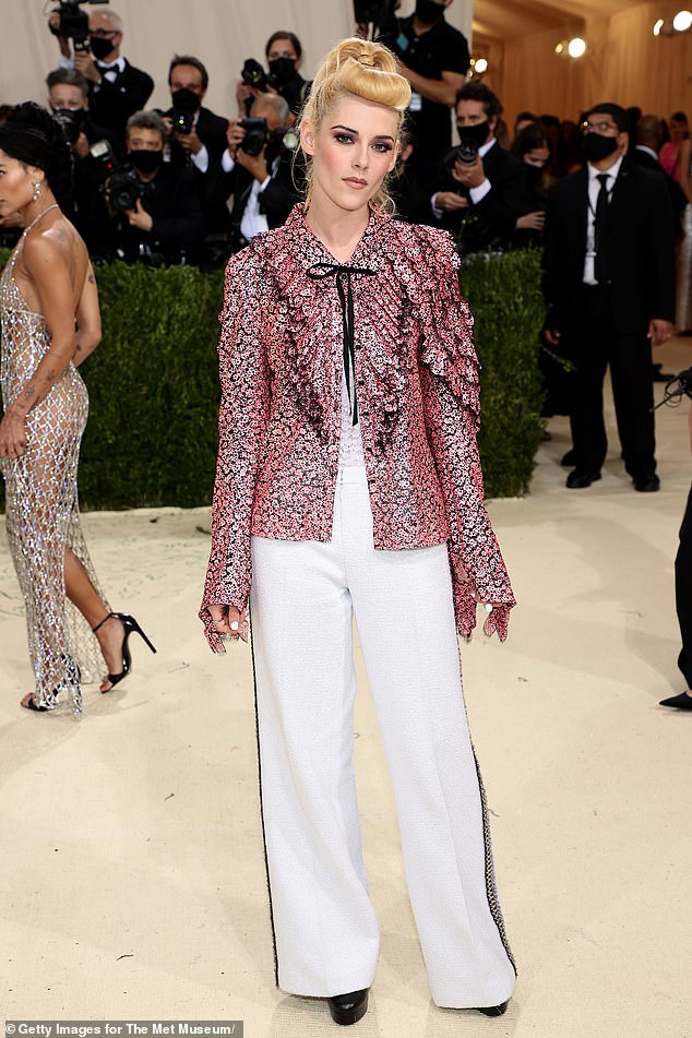 What a doll: Kristin Stewart was ultra girly in pink Chanel during Monday night's Met Gala