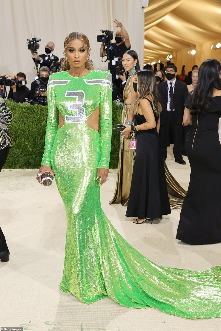 Football wife: Ciara, who is married to football star Russell Wilson, donned a neon green jersey inspired number while carrying a football shaped handbag. She is wearing Dundas