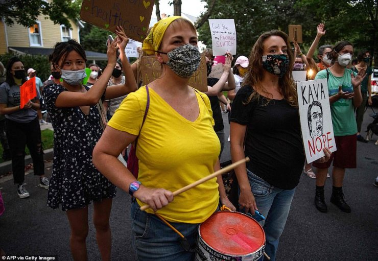 Protestors marched the short distance from the Chevy Chase Park in Maryland to Kavanaugh's home, where the lights were on but no one appeared to be home