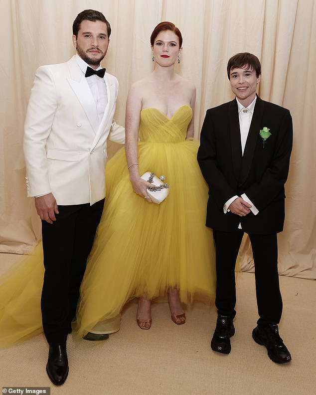 Colorful: Kit was Elliot's inverse with a white tuxedo jacket, while his wife and former costar Rose looked glamorous in a voluminous yellow tulle dress