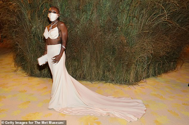 On point: Cynthia was vaccinated against Covid-19 (as required for attendance) and wore a white satin mask to match her dress